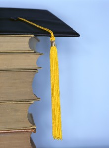 Tassel Hanging on Pile of Textbooks