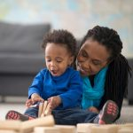 mom and child playing with blocks