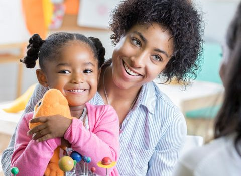 mom with child talking with teacher