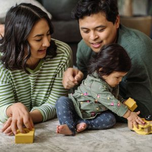 parents and child playing with blocks