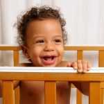 child looking out of crib
