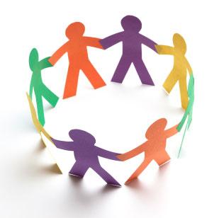 paper figures of children holding hands
