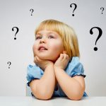 child with question marks around head