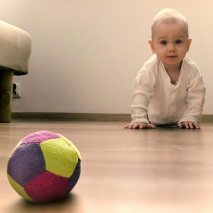 child crawling to ball
