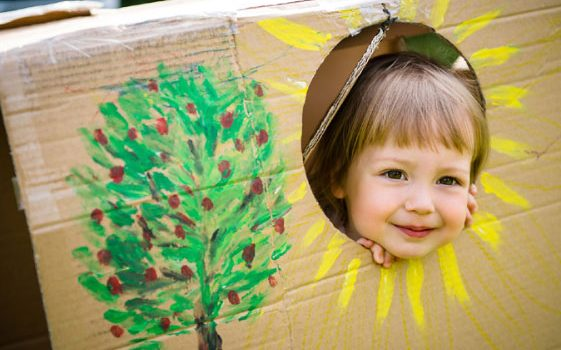 child peeking head out of box