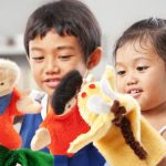 boy and girl playing with puppets