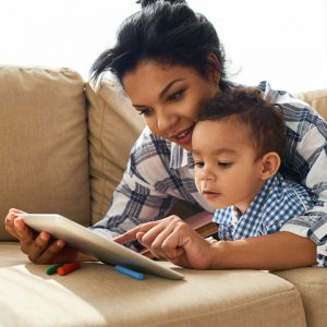 mom reads to young child